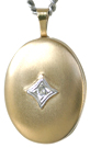 gold oval locket with diamond