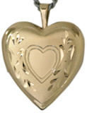 gold heart and scroll heart locket