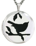 round locket with bird