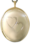 25 oval locket with two hearts