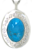 embossed locket with turquoise stone